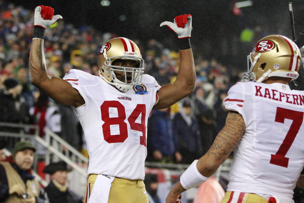 San Francisco 49ers wide receiver Randy Moss (84) celebrates a touchdown catch during the first quarter of an NFL football game against the New England Patriots in Foxborough, Mass., in 2012. (AP  ...