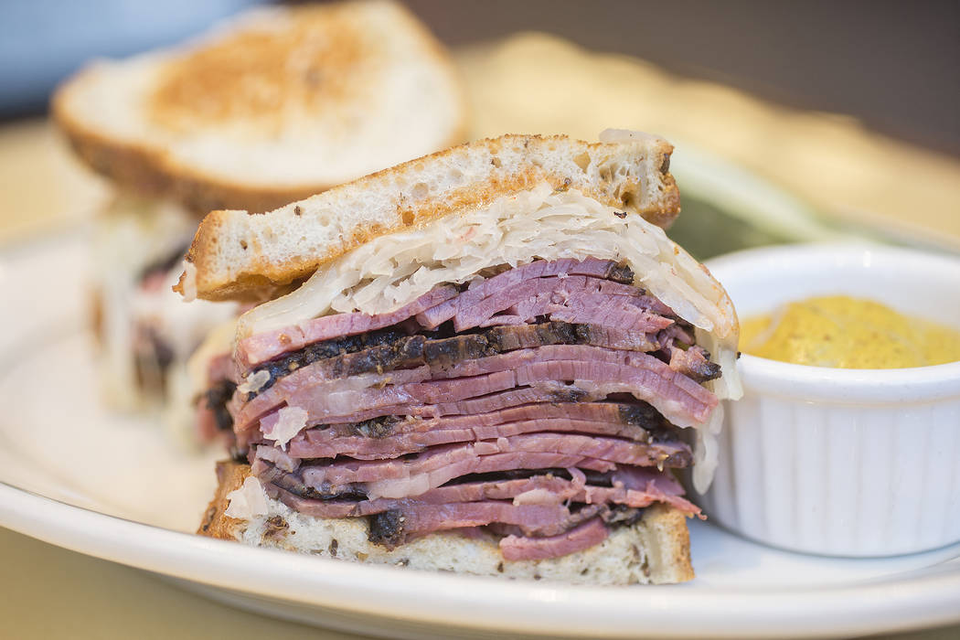 Pastrami reuben with swiss cheese, sauerkraut and Russian dressing on grilled rye bread at Canter's Deli on Friday, February 16, 2018, at Tivoli Village, in Las Vegas. Benjamin Hager Las Vegas Rev ...
