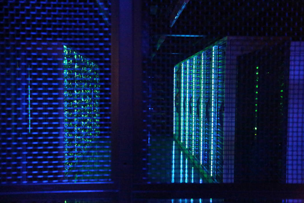 Racks of computer servers light the corridor between hot aisle containment rows at the Switch Core Campus in Las Vegas on Monday, Jan. 15, 2018 Michael Quine Las Vegas Review-Journal @Vegas88s
