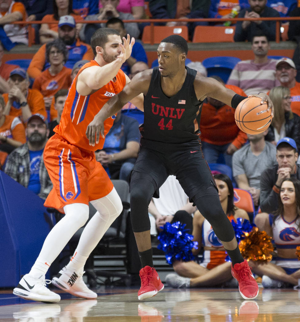 UNLV's Brandon McCoy (44) is defended by Boise State's David Wacker during the first half of an NCAA college basketball game in Boise, Idaho, Saturday, Feb. 3, 2018. (AP Photo/Otto Kitsinger)