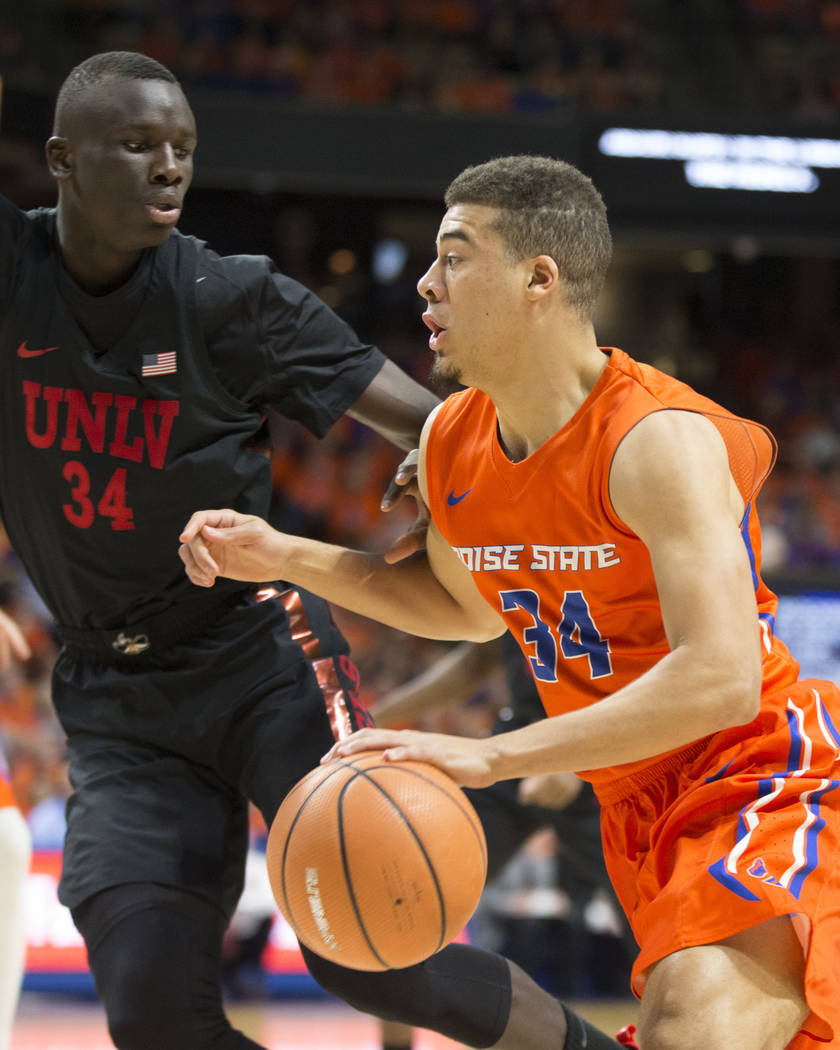 Boise State's Alex Hobbs moves the ball against UNLV's Cheikh Mbacke Diong during the first half of an NCAA college basketball game in Boise, Idaho, Saturday, Feb. 3, 2017. Boise State won 93-91 i ...