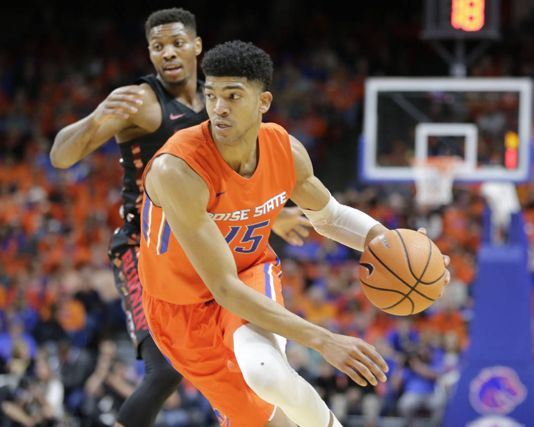 Boise State's Chandler Hutchison (15) moves the ball during the first half of an NCAA college basketball game against UNLV in Boise, Idaho, Saturday, Feb. 3, 2017. Boise State won 93-91 in overtim ...