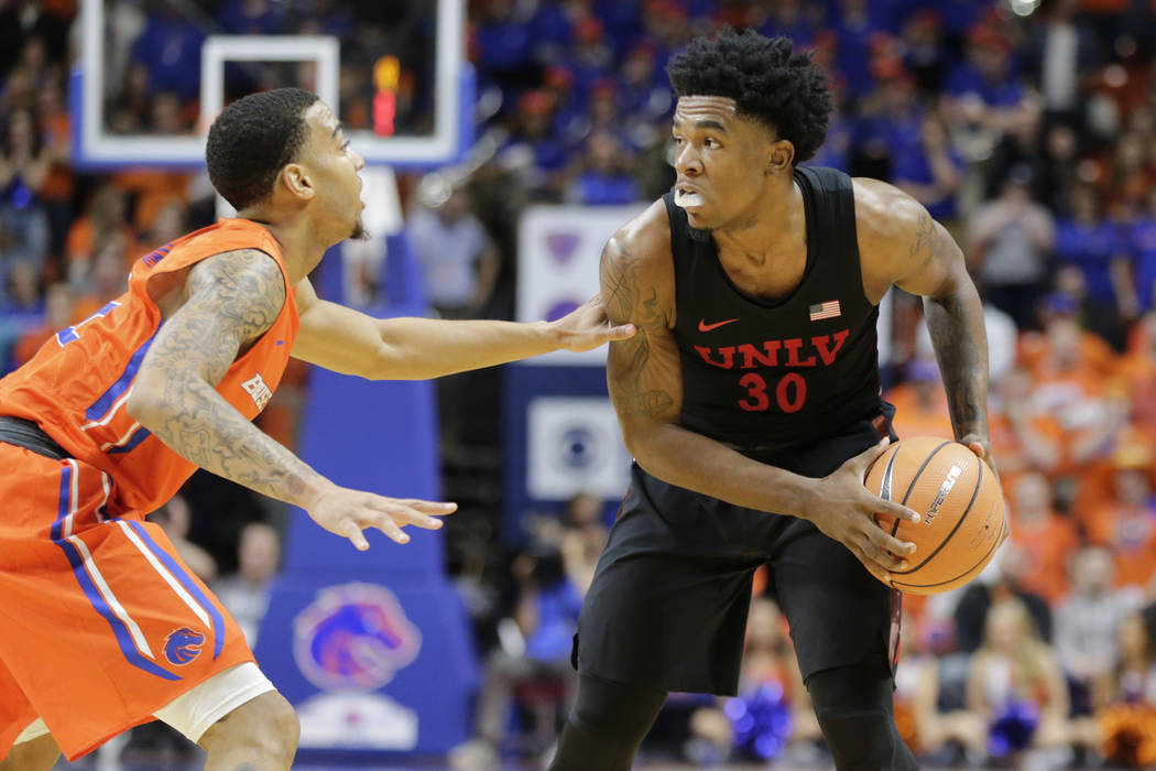 UNLV's Jovan Mooring (30) defends the ball from Boise State's Marcus Dickinson during the first half of an NCAA college basketball game in Boise, Idaho, Saturday, Feb. 3, 2017. Boise State won 93- ...