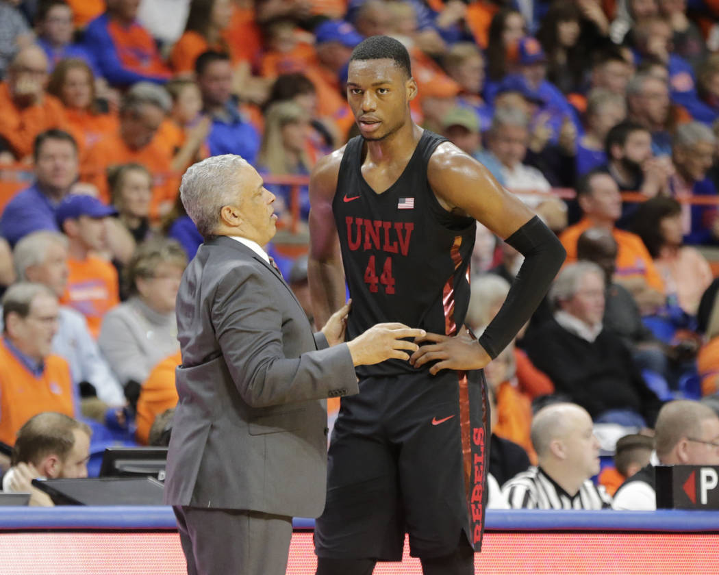 UNLV head coach Marvin Menzies talks with Brandon McCoy (44) during the second half of an NCAA college basketball game against Boise State in Boise, Idaho, Saturday, Feb. 3, 2017. Boise State won  ...