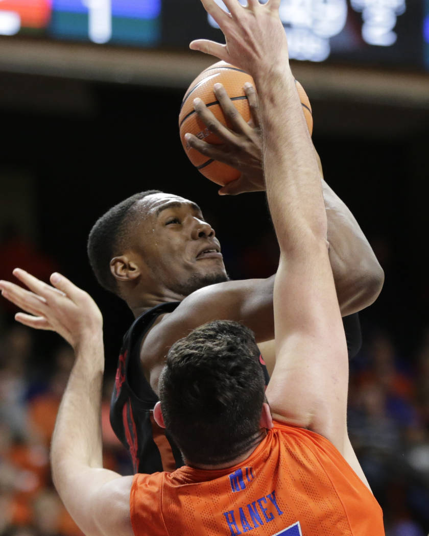 UNLV's Brandon McCoy looks to the basket past Boise State's Zach Haney during the second half of an NCAA college basketball game in Boise, Idaho, Saturday, Feb. 3, 2017. Boise State won 93-91 in o ...