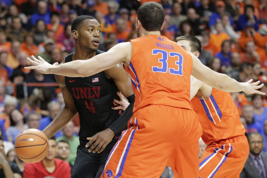 UNLV's Brandon McCoy (44) looks for a pass around Boise State's David Wacker (33) during the second half of an NCAA college basketball game in Boise, Idaho, Saturday, Feb. 3, 2017. Boise State won ...