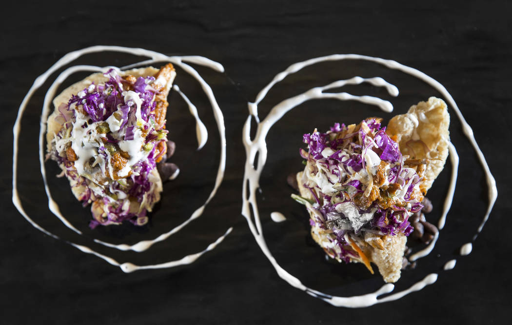 Chicharron tostada chipotle chicken tinga with a jalapeo coleslaw, black beans and crema at Kitchen Table Squared on Thursday, March 1, 2018, in Las Vegas. Benjamin Hager Las Vegas Review-Journal  ...