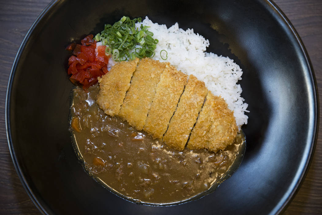The katsu curry rice bowl served with pork tenderloin coated and fried with toasted panko, on a bed of Japanese rice, at Cafe Sanuki in Las Vegas, Thursday, March 8, 2018. Erik Verduzco Las Vegas  ...