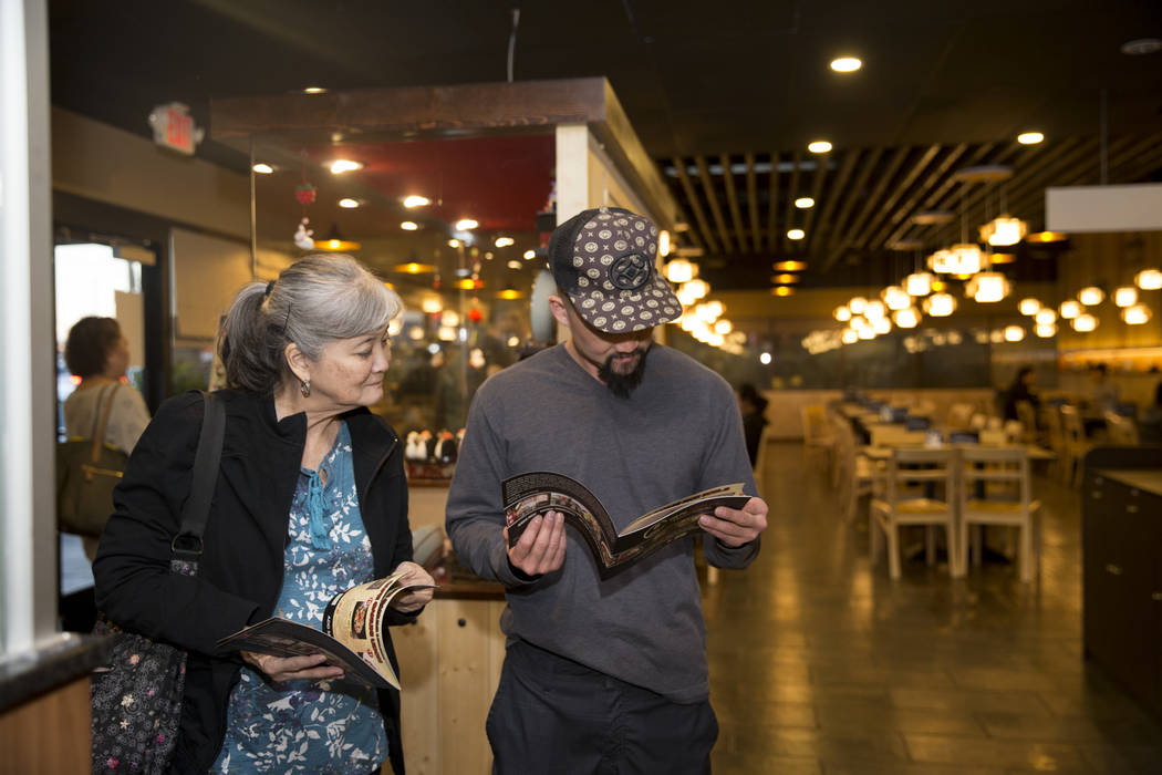 Janice Toshikiyo, left, with her son Trevor, look at the menu at Cafe Sanuki in Las Vegas, Thursday, March 8, 2018. Erik Verduzco Las Vegas Review-Journal @Erik_Verduzco