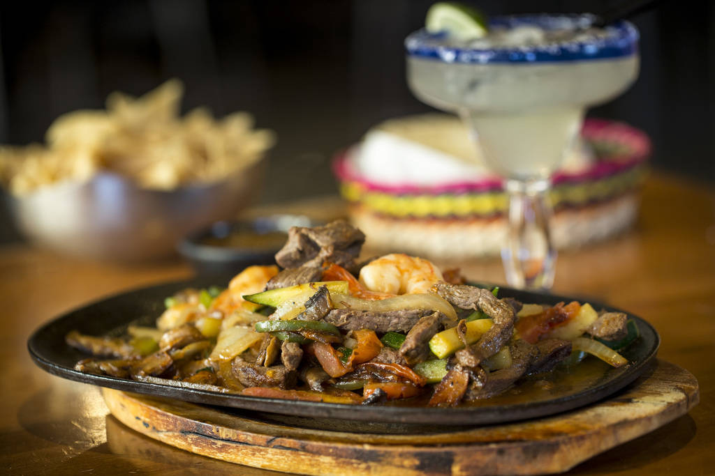 The carne asada and shrimp parillada (fajitas) served with chips and salsa and a traditional margarita at Leticia's Mexican Cocina located at Tivoli Village at Queensridge in Las Vegas on Monday,  ...
