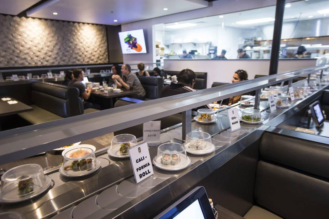 California rolls pass by on the conveyor belt at Sapporo Revolving Sushi in Las Vegas on Wednesday, April 25, 2018. Chase Stevens Las Vegas Review-Journal @csstevensphoto