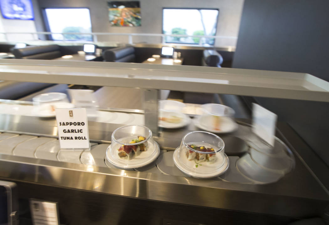 A Sapporo garlic tuna roll passes by on the conveyor belt at Sapporo Revolving Sushi in Las Vegas on Wednesday, April 25, 2018. Chase Stevens Las Vegas Review-Journal @csstevensphoto