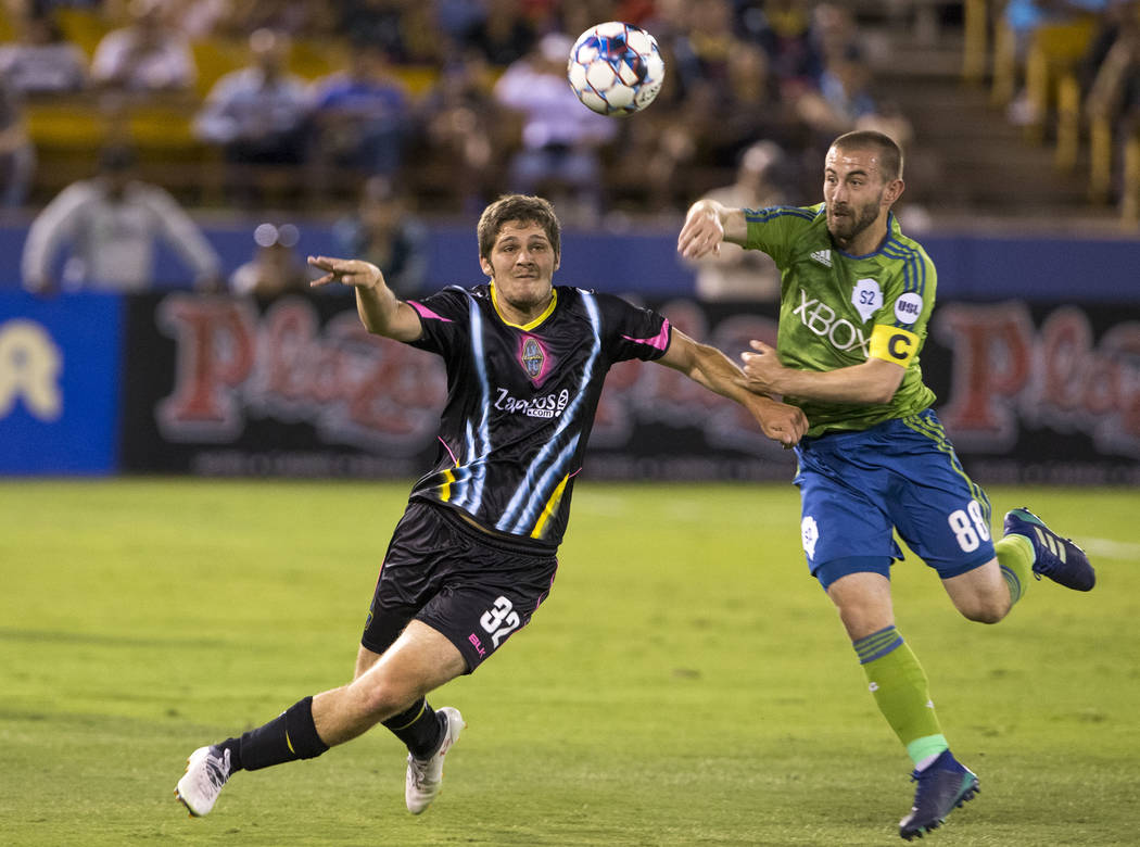 Las Vegas Lights FC midfielder Zach Mather (32) and Seattle Sounders FC 2 midfielder Ray Saari (88) vie for the ball during the first half of a United Soccer League match at Cashman Field in downt ...