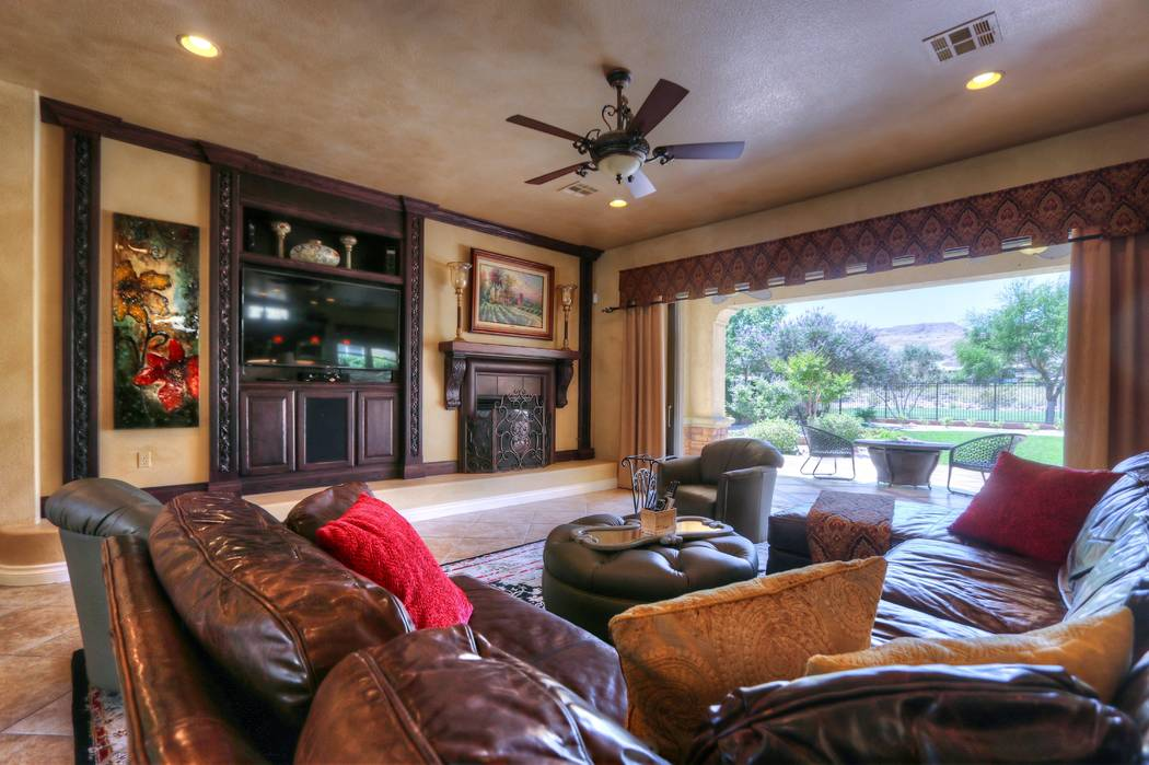 The living room opens to the patio that overlooks the golf course. (Lisa Paquette TourFactory)