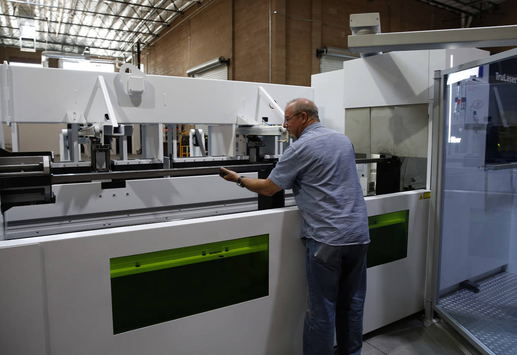 Barry Yost, co-owner of Precision Tube Laser, LLC, places a metal pipe into the TruLaser Tube 5000 laser cutting machine on Wednesday, June 20, 2018, in Las Vegas. Bizuayehu Tesfaye/Las Vegas Revi ...