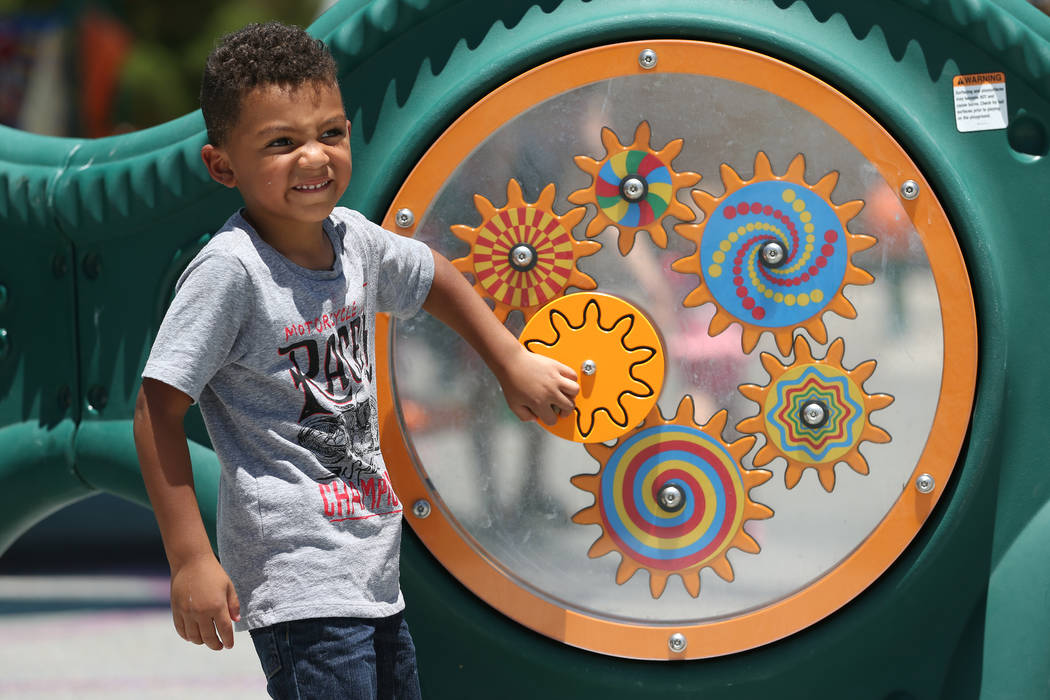 Jacob Clark, 4, plays with the newly installed sensory wall at Gilcrease Brothers Park in Las Vegas, Saturday, June 23, 2018. The sensory wall is the first to be installed in a city park according ...