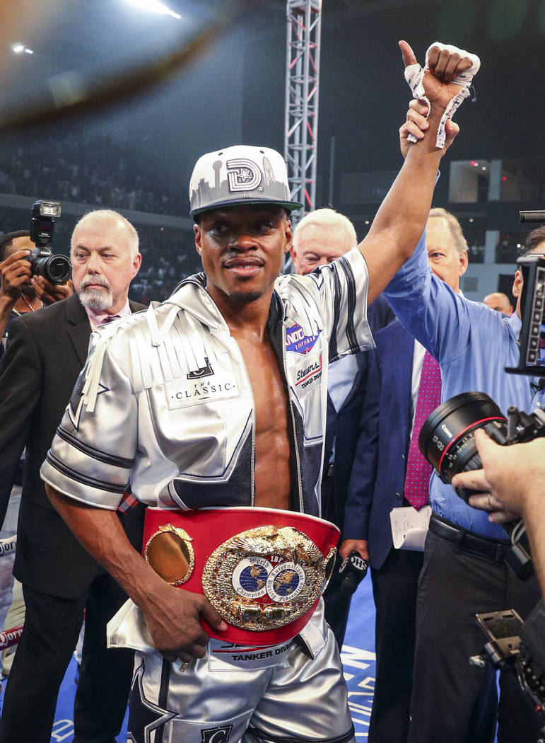 Errol Spence Jr. is declared the winner by knockout over Carlos Ocampo in the first round of an IBF welterweight title boxing match Saturday, June 16, 2018, in Frisco, Texas. (AP Photo/Richard W. ...
