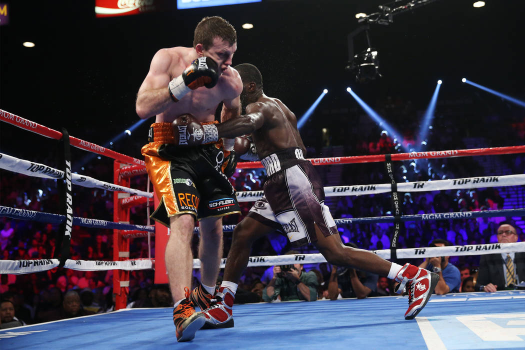 Terence Crawford, right, connects a punch against Jeff Horn in the WBO welterweight World Title bout at the MGM Grand Garden Arena in Las Vegas, Saturday, June 9, 2018. Crawford won by technical k ...