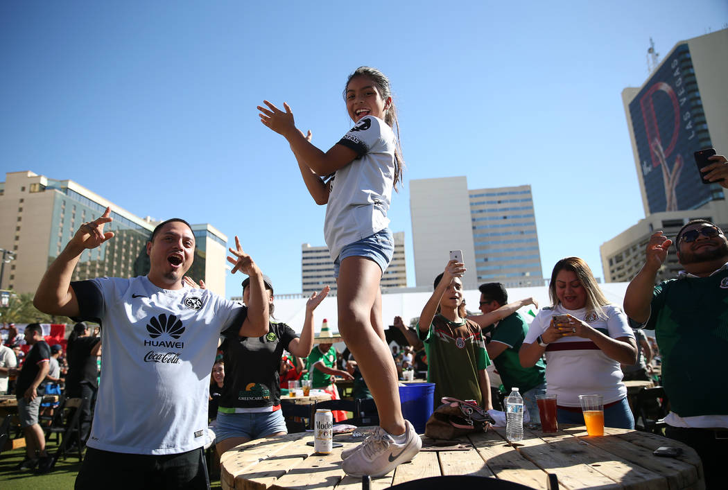 Juan Garcia, left, and his daughter Vivian of Las Vegas, celebrate a goal by Mexico against South Korea during a watch party of the World Cup soccer match at the Downtown Las Vegas Events Center i ...