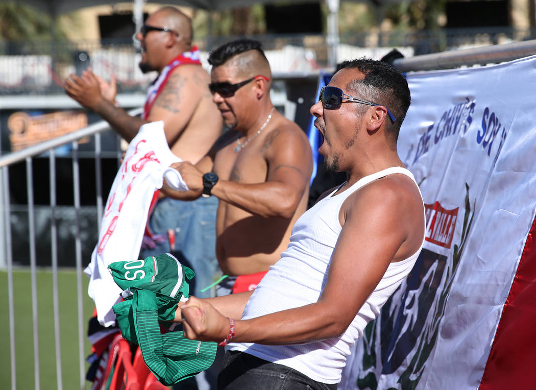 Geovanni Reyes, from left, Alberto Arias, and Federico Cabrera of Los Angeles, cheer during a watch party for the World Cup soccer match between Mexico and South Korea at the Downtown Las Vegas Ev ...