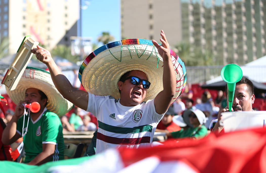 Milo Nino, center, cheers during a watch party for the World Cup soccer match between Mexico and South Korea at the Downtown Las Vegas Events Center in Las Vegas, Saturday, June 23, 2018. Erik Ver ...