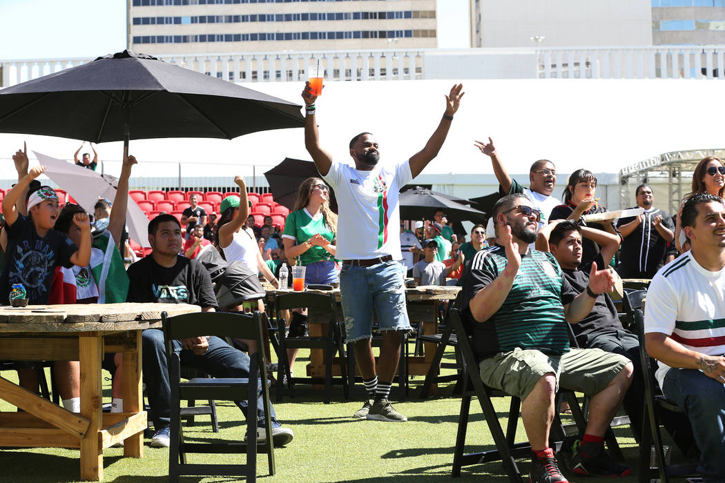 Fans react to the 2-1 win by Mexico against South Korea during a watch party of the World Cup soccer match at the Downtown Las Vegas Events Center in Las Vegas, Saturday, June 23, 2018. Erik Verdu ...