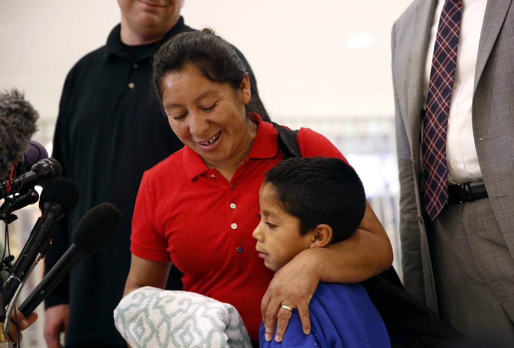 Beata Mariana de Jesus Mejia-Mejia, left, embraces her son Darwin Micheal Mejia as she speaks at a news conference following their reunion at Baltimore-Washington International Thurgood Marshall A ...