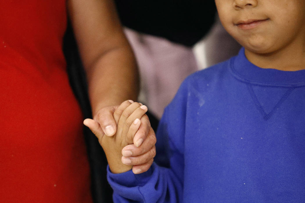 Darwin Micheal Mejia, right, holds hands with his mother, Beata Mariana de Jesus Mejia-Mejia, during a news conference following their reunion at Baltimore-Washington International Thurgood Marsha ...