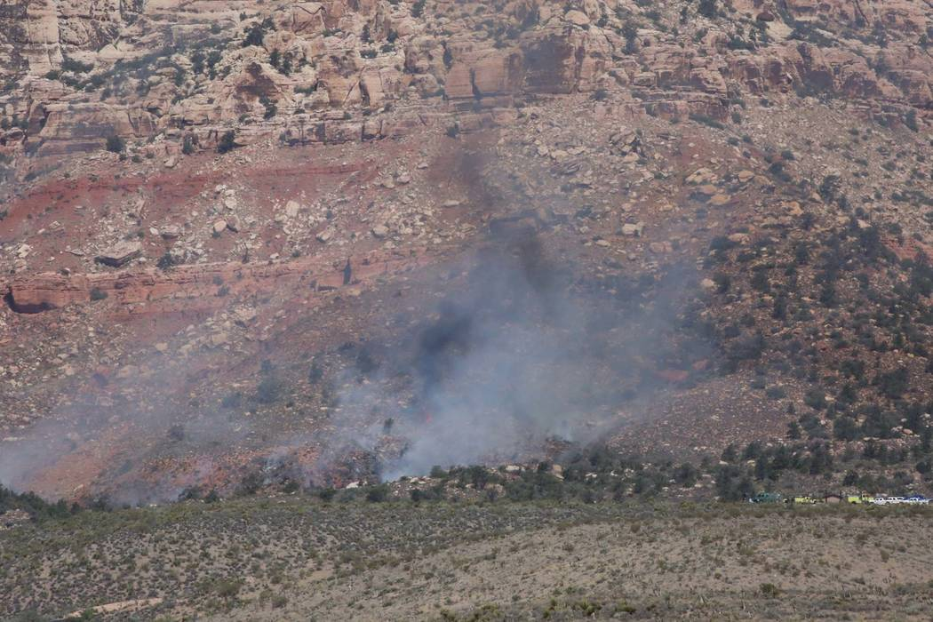 Smoke from a wildfire is seen at the Pine Creek trail, off the 13-mile scenic loop of the Red Rock National Conservation Area on Friday, June 22, 2018, in Las Vegas. Bizuayehu Tesfaye/Las Vegas Re ...
