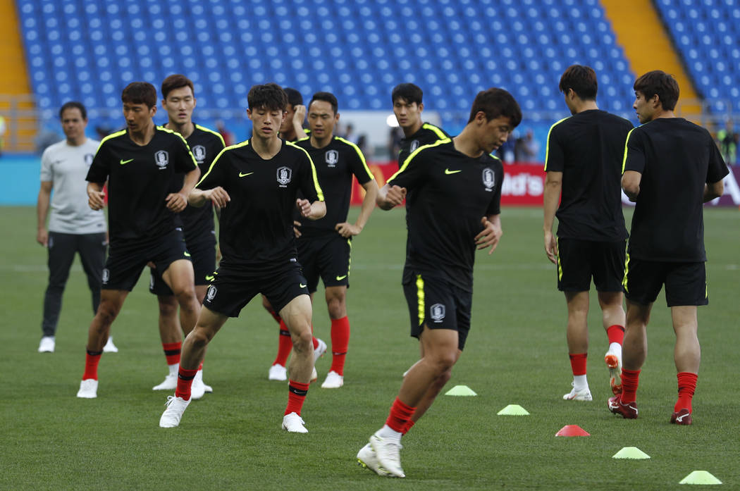 South Korea's players warm up during South Korea's official training on the eve of the group F match between South Korea and Mexico at the 2018 soccer World Cup at the Rostov Arena, in Rostov-on-D ...