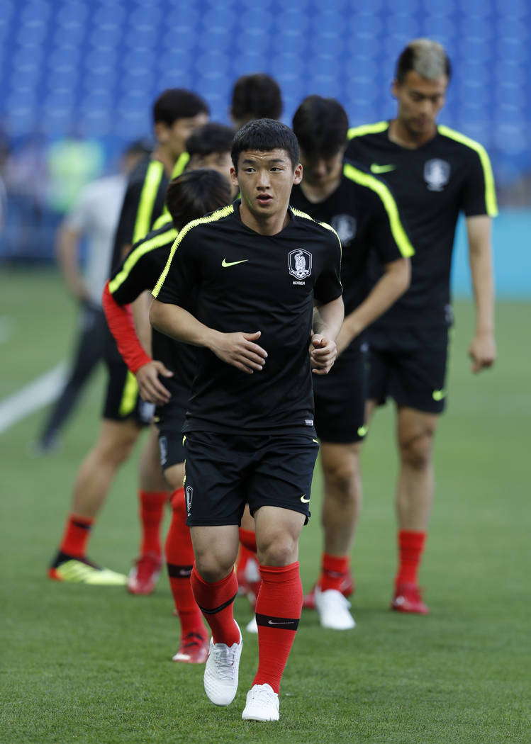 South Korea's Kim Min-woo warm up during South Korea's official training on the eve of the group F match between South Korea and Mexico at the 2018 soccer World Cup at the Rostov Arena, in Rostov- ...