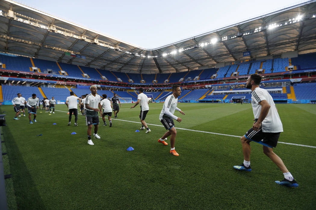 Mexico's players warm up during Mexico's official training on the eve of the group F match between South Korea and Mexico at the 2018 soccer World Cup at the Rostov Arena, in Rostov-on-Don, Russia ...