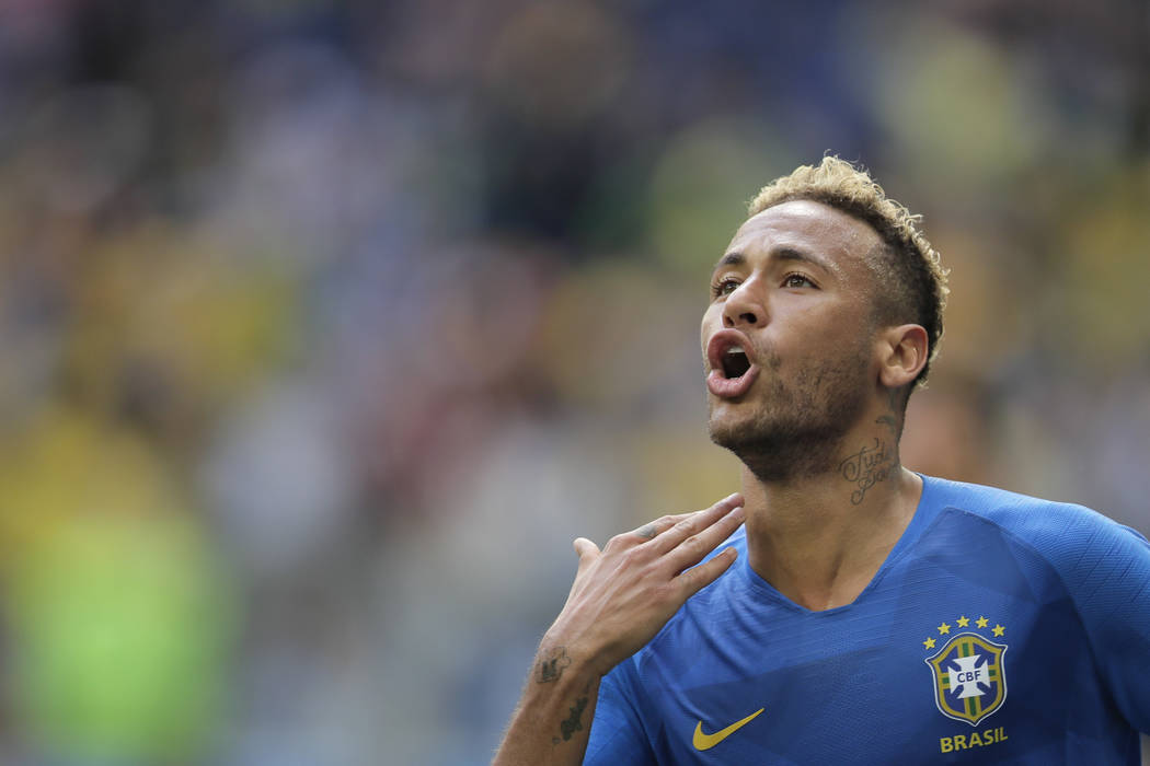 Brazil's Neymar celebrates after scoring his side's second goal during the group E match between Brazil and Costa Rica at the 2018 soccer World Cup in the St. Petersburg Stadium in St. Petersburg, ...