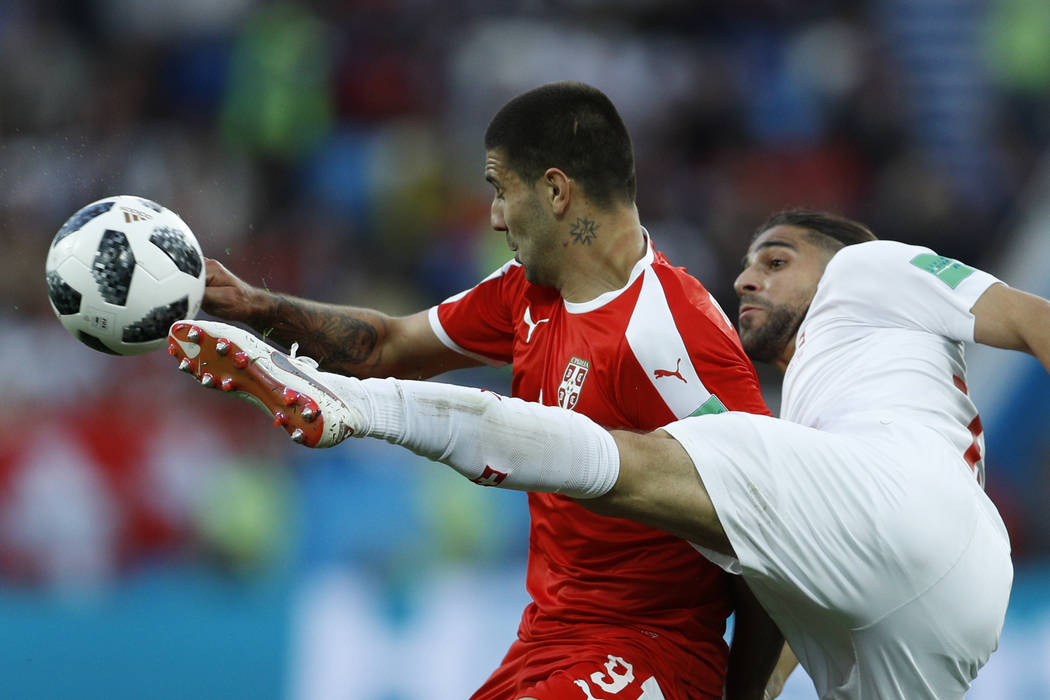 Serbia's Aleksandar Mitrovic, left, and Switzerland's Ricardo Rodriguez vie for the ball during the group E match between Switzerland and Serbia at the 2018 soccer World Cup in the Kaliningrad Sta ...