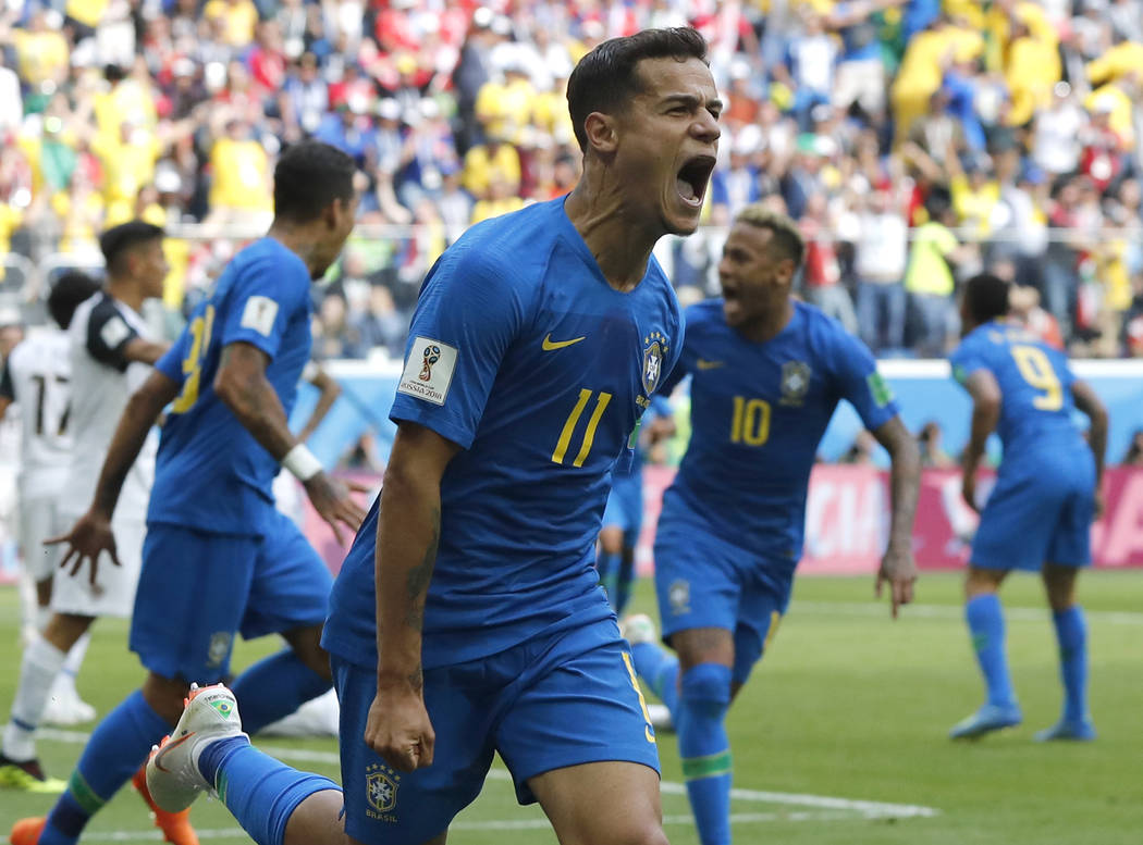 Brazil's Philippe Coutinho celebrates scoring his side's opening goal during the group E match between Brazil and Costa Rica at the 2018 soccer World Cup in the St. Petersburg Stadium in St. Peter ...
