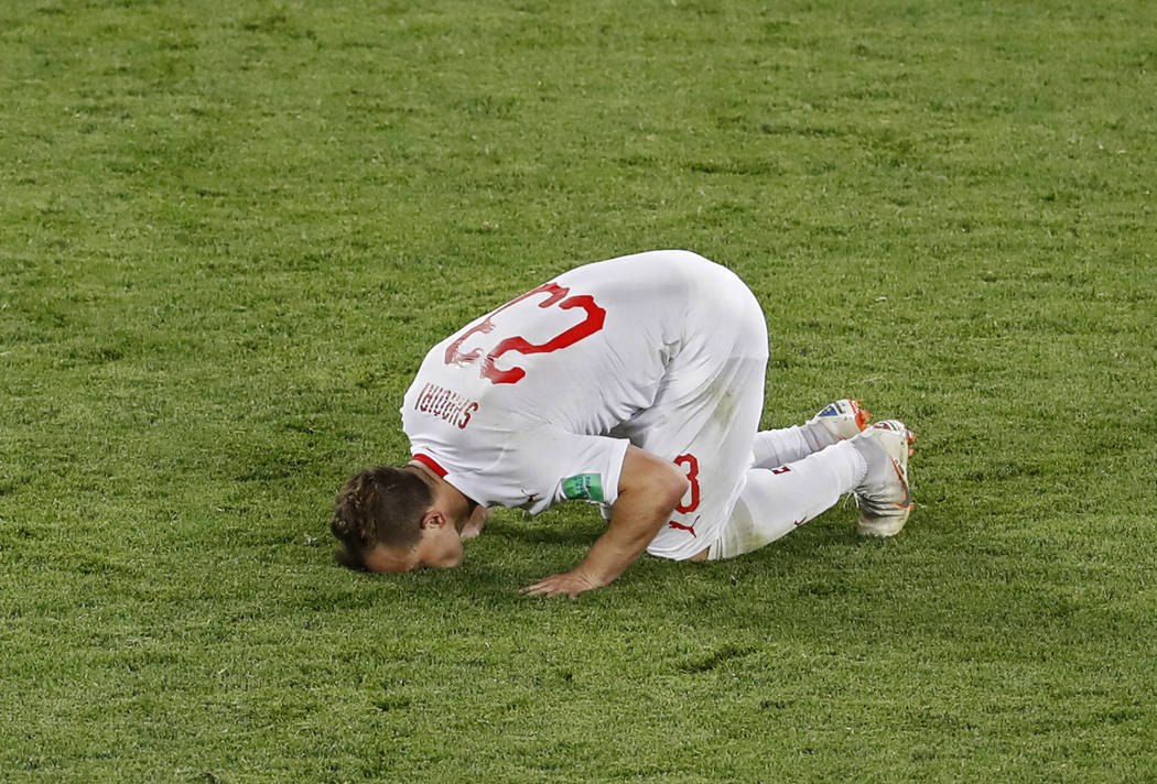 Switzerland's Xherdan Shaqiri kisses the pitch after scoring his side's second goal during the group E match between Switzerland and Serbia at the 2018 soccer World Cup in the Kaliningrad Stadium ...