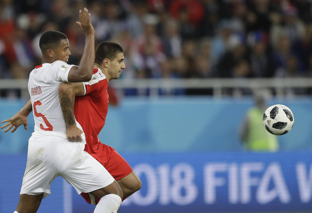 Switzerland's Manuel Akanji, left, and Serbia's Aleksandar Mitrovic challenge for the ball during the group E match between Switzerland and Serbia at the 2018 soccer World Cup in the Kaliningrad S ...
