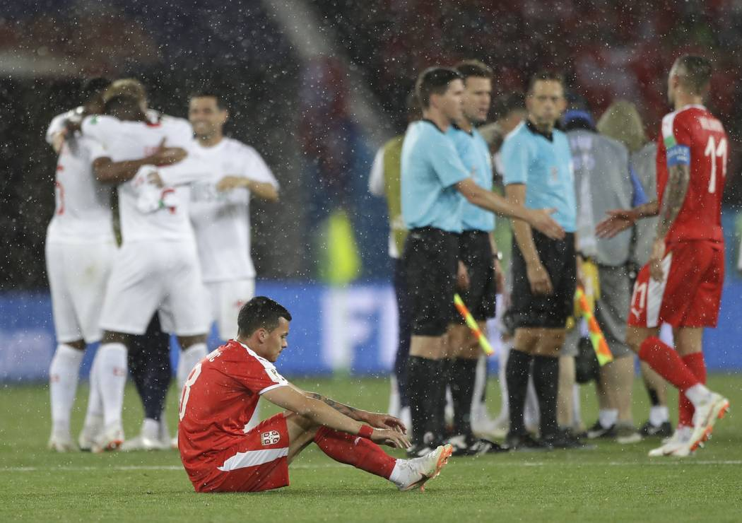 Serbia's Nemanja Radonjic, foreground, reacts in dejection at the end of the group E match between Switzerland and Serbia at the 2018 soccer World Cup in the Kaliningrad Stadium in Kaliningrad, Ru ...