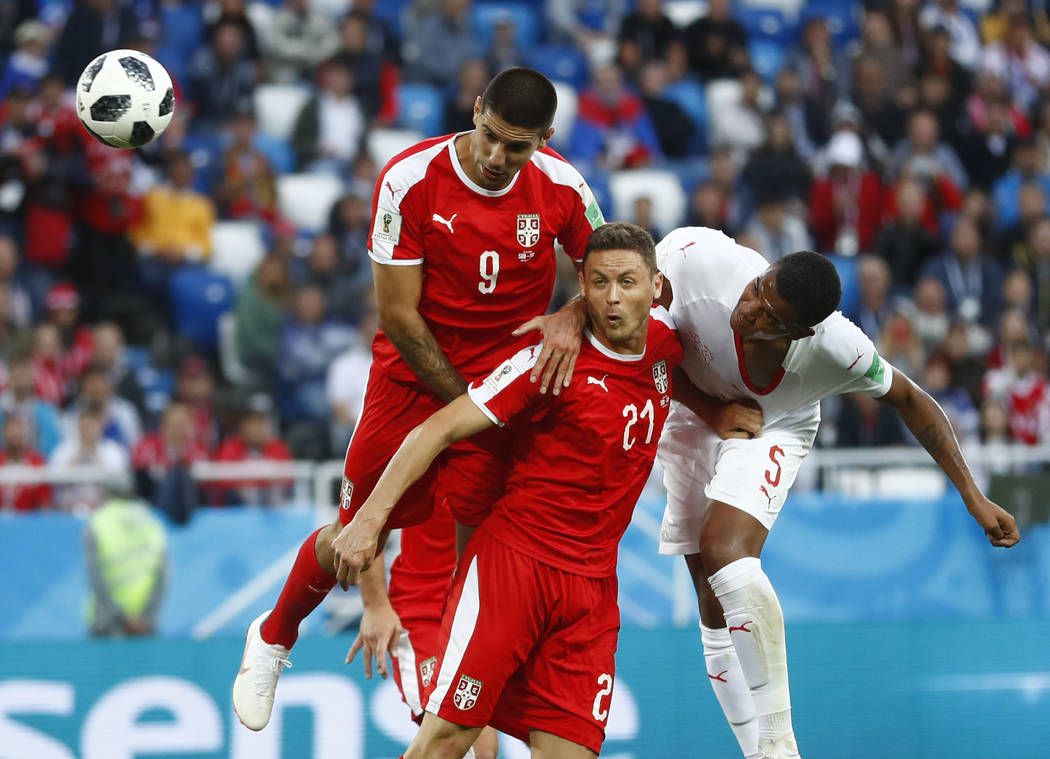 Serbia's Aleksandar Mitrovic, left, Serbia's Nemanja Matic, centre, and Switzerland's Manuel Akanji challenge for the ball during the group E match between Switzerland and Serbia at the 2018 socce ...