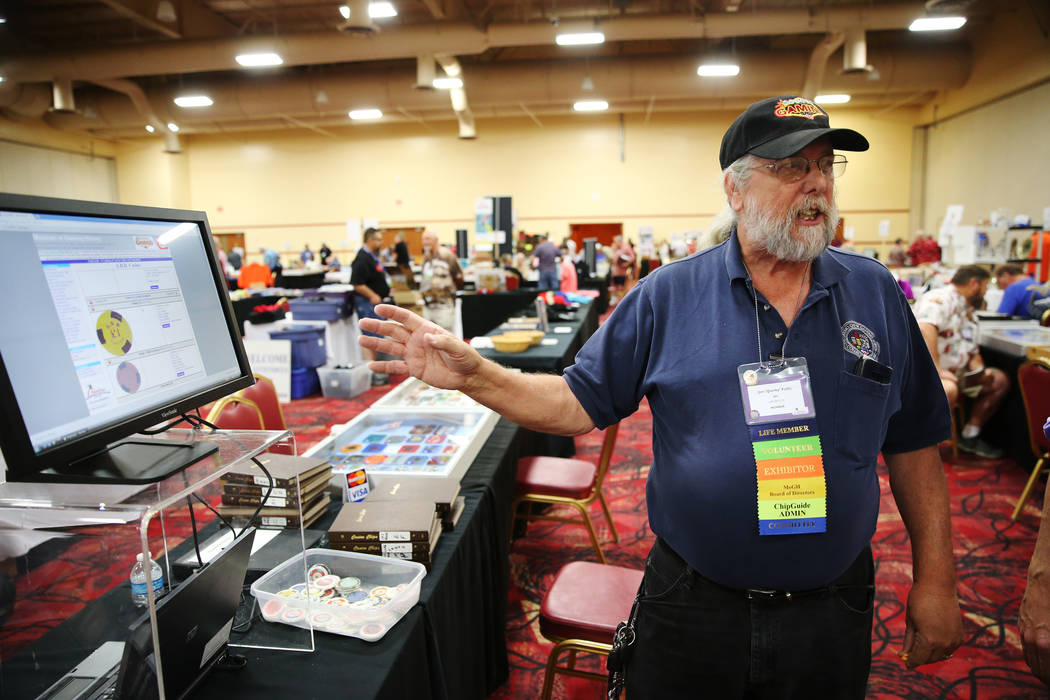Jim Follis talks about an online chip guide he helps manage during the Casino Chip & Gaming Token Collectors Club annual convention at the South Point casino-hotel in Las Vegas, Friday, June 2 ...