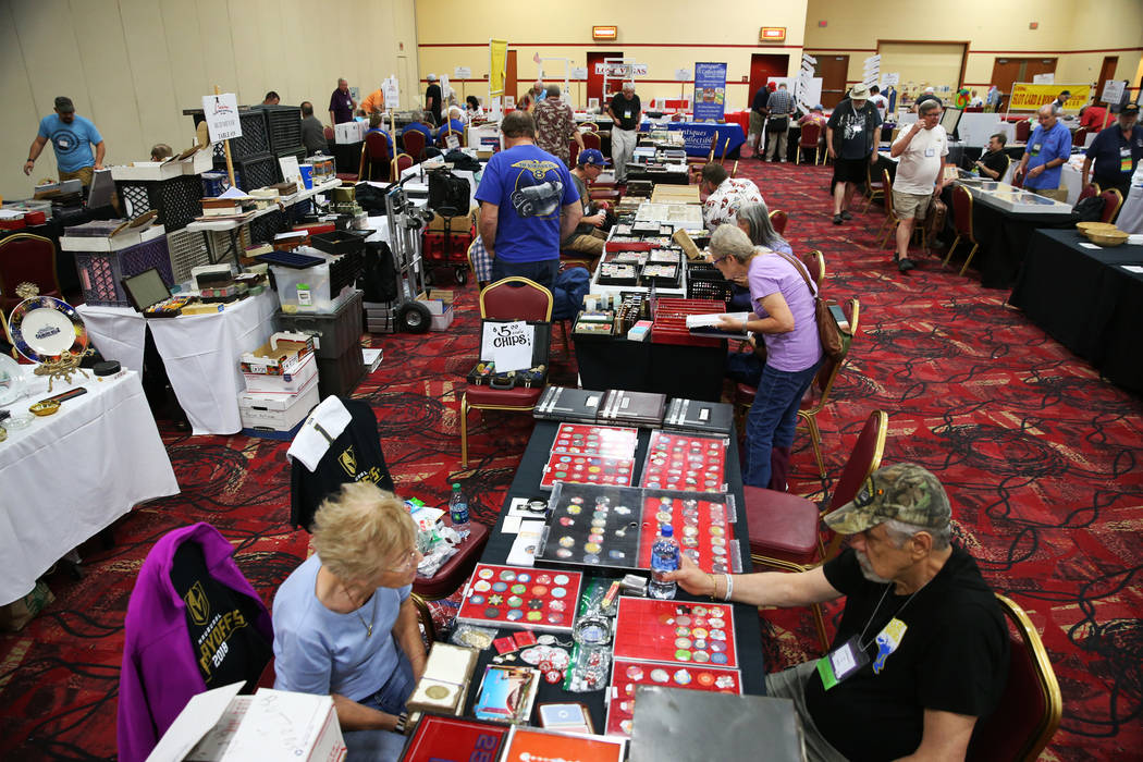 People browse the Casino Chip & Gaming Token Collectors Club annual convention at the South Point casino-hotel in Las Vegas, Friday, June 22, 2018. Erik Verduzco Las Vegas Review-Journal @Erik ...