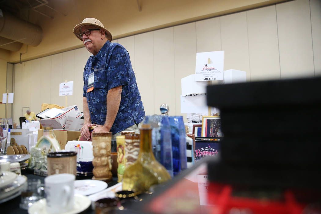 Jerry Birl of Delaware with his memorabilia collection for sale during the Casino Chip & Gaming Token Collectors Club annual convention at the South Point casino-hotel in Las Vegas, Friday, Ju ...