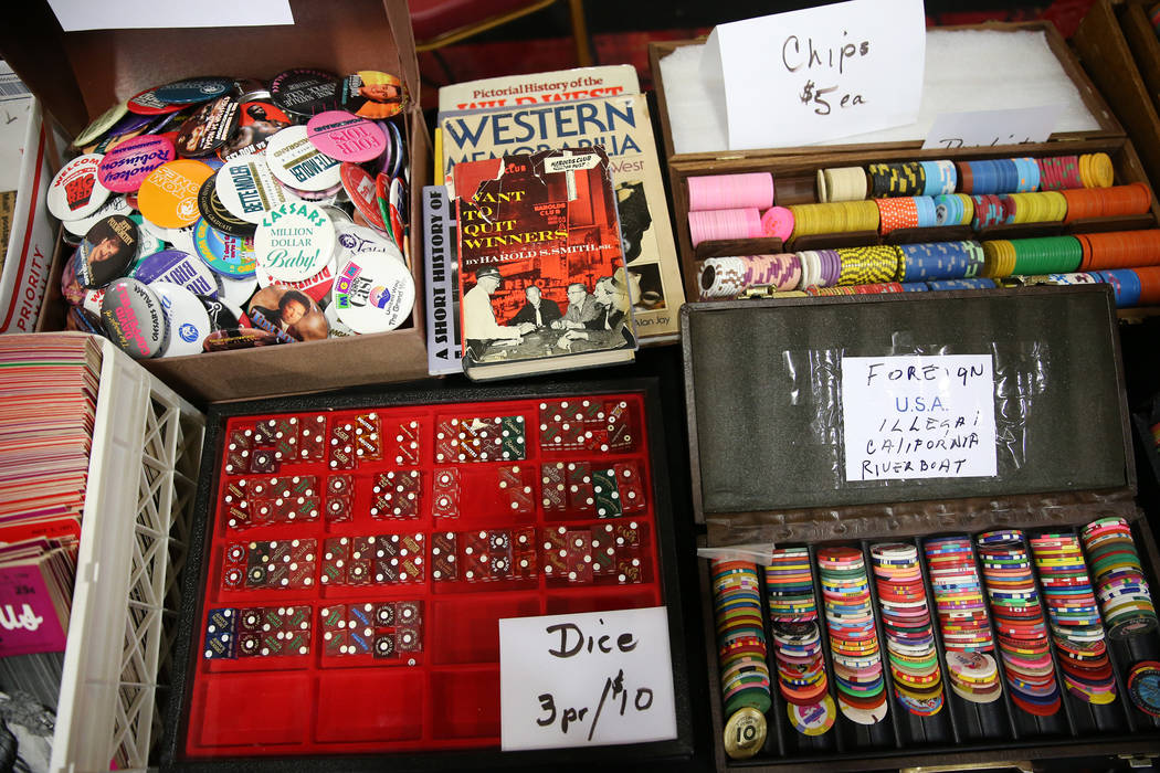 A collection of dice and chips owned by Bill Judge for sale during the Casino Chip & Gaming Token Collectors Club annual convention at the South Point casino-hotel in Las Vegas, Friday, June 2 ...