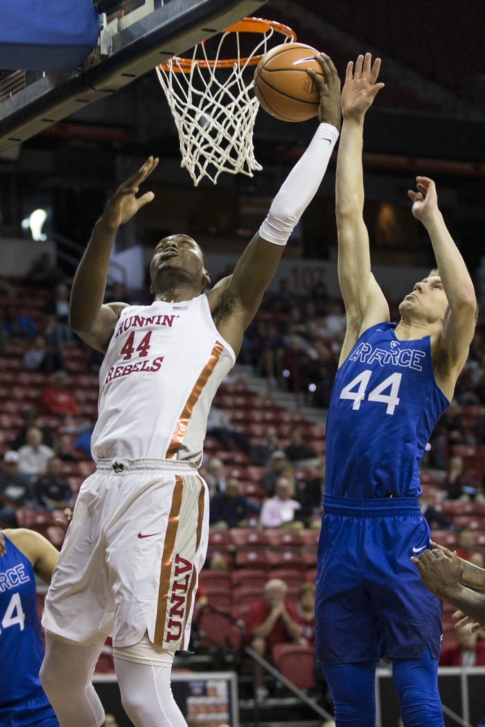 UNLV Rebels forward Brandon McCoy (44) shoots for a score against pressure from Air Force Falcons guard Keaton Van Soelen (44) in the first half of the Mountain West Conference men's basketball&#x ...