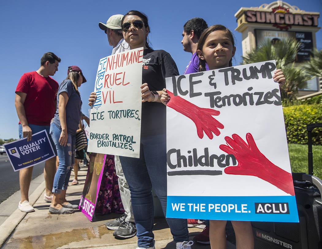 Jiulianna Levine, right, protests outside Suncoast hotel-casino ahead of President Donald Trump's appearance on Saturday, June 23, 2018, in Las Vegas. Benjamin Hager Las Vegas Review-Journal @benj ...