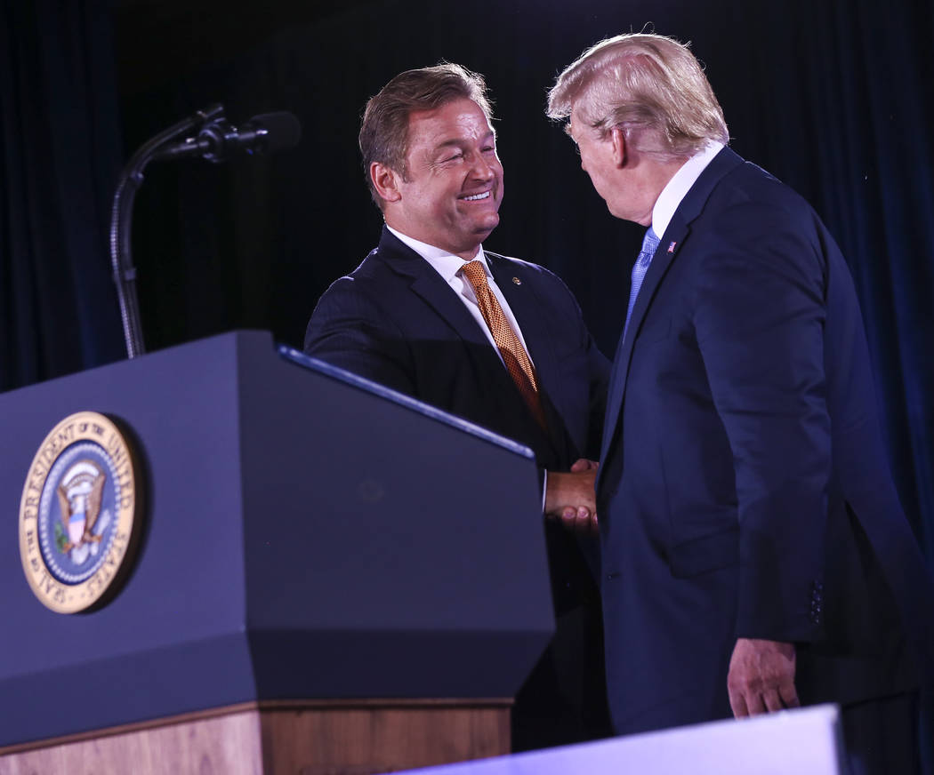 President Donald Trump greets U.S. Sen. Dean Heller, R-Nev., during the keynote address at the Nevada Republican Party State Convention at the Suncoast in Las Vegas on Saturday, June 23, 2018. Cha ...