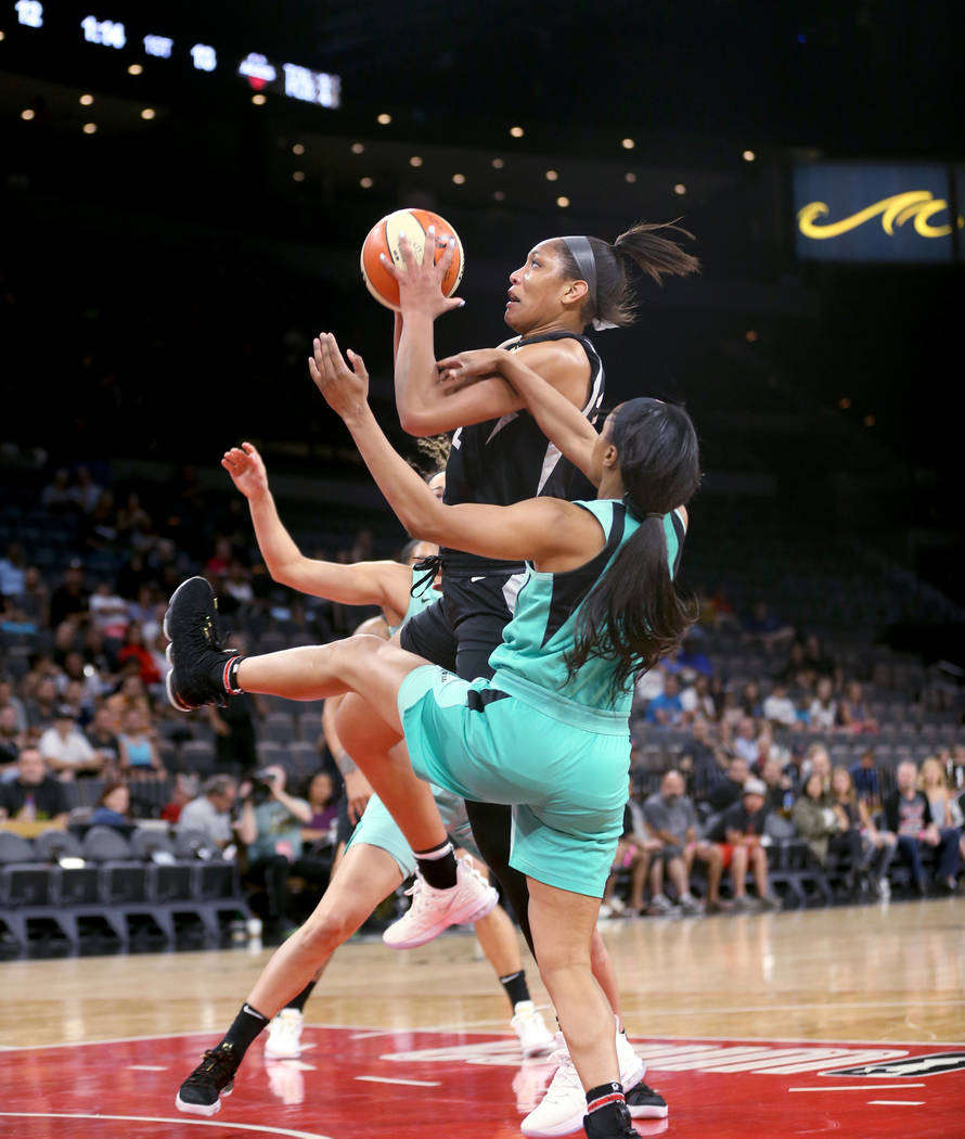 Las Vegas Aces center A'ja Wilson (22) goes up for a shot in front of New York Liberty guard Brittany Boyd (15) in the first half of a WNBA basketball game at the Mandalay Bay Events Center in Las ...