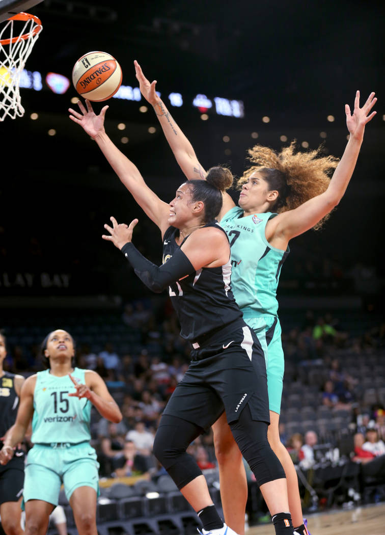 Las Vegas Aces guard Kayla McBride (21) shoots in front of New York Liberty center Amanda Zahui B. (17) in the first half of a WNBA basketball game at the Mandalay Bay Events Center in Las Vegas o ...