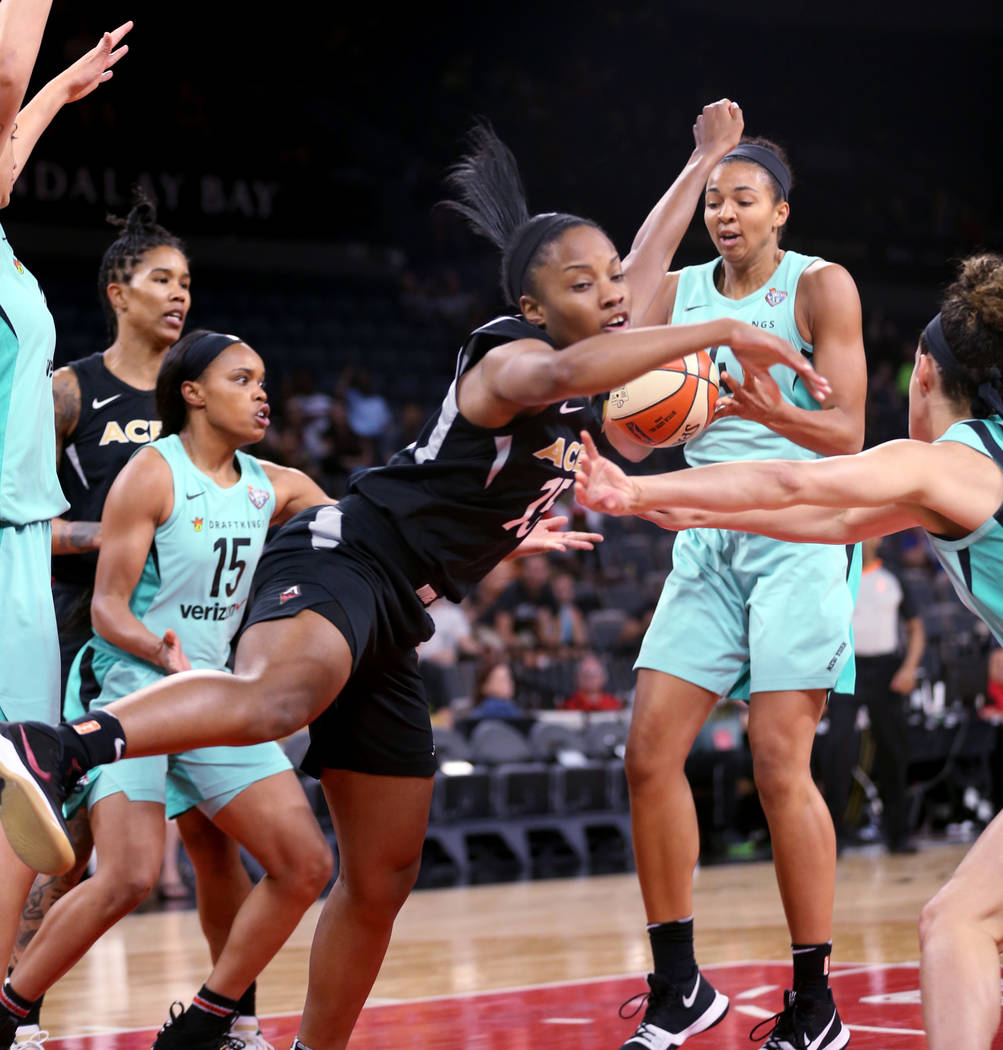 Las Vegas Aces guard Lindsay Allen (15) goes for a loose ball between New York Liberty guard Brittany Boyd (15) and New York Liberty center Kiah Stokes (41) in the first half of a WNBA basketball ...