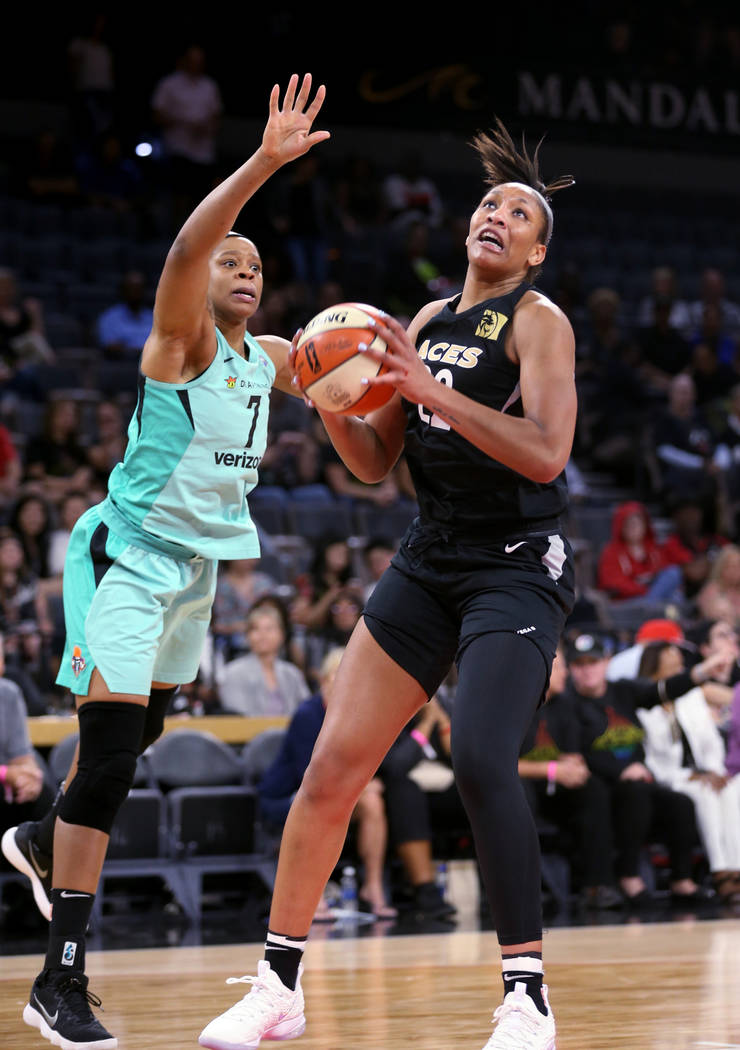 Las Vegas Aces center A'ja Wilson (22) looks to shoot in front of New York Liberty center Kia Vaughn (7) in the first half of a WNBA basketball game at the Mandalay Bay Events Center in Las Vegas ...